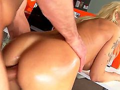 Perfect bodied tattooed blond MILF Devon is dangerously sexy. This tattooed beauty with nice boobs  gives head and gets her pink pussy stuffed before anal sex. Toni Ribas sticks his finger in her tight asshole before she takes his cock.