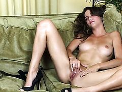 Malena Morgan kills time dildoing her wet spot for camera