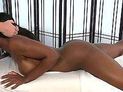 Dark skinned naked beauty Persia Black shows off her wonderful bubble butt and her juicy boobs as she gives interracial blowjob to hot white guy Ryan McLane. She loves his ivory love stick.