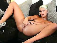 Gorgeous blonde Blanche Bradburry in sexy high heels shows off her long legs and perfect apple ass while she bangs her beautiful puffy pussy with two fingers. Watch her drill her hole!