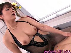 Japanese mature looking so sexy and hot in her fishnets lingerie and here she gives her husband a sensual oily nuru massage before riding his cock exploding it inside her hairy cunt.