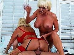 Lucky guy gets tag teamed by busty MILFs Nikita Von James and Tara Holiday