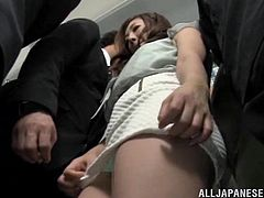 She hikes up her skirt in public, so her man can stick his fingers right up into her cunt and get her off. She doesn't care who see what they are doing, because she is so horny and wants to cum. Her pussy juice is dripping on his fingers.