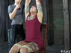 Tattooed brunette porn actress is tied up in bdsm room