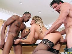 It's hard for her to decide, which cock will she choose? The big black dong looks appetizing for Capri, but she doesn't wants to leave her husband's. Oh well, it seems she will have to take both. The busty blonde wife greedily fills herself with both dicks, but which one will cum first in her?