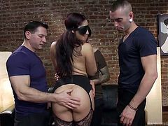 Sheena likes when she's in the center of attention, especially when surrounded by more horny guys. The long brown-haired slutty lady is blindfolded and the men admire her round crazy ass. Click to see the bitch with small tits, wearing stockings down on knees, sucking cocks with a frenetically passion.