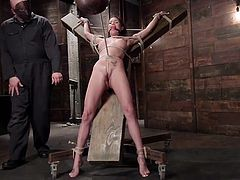 Raven is tied up and gagged by her cruel masked master in this creepy dungeon. The ropes are wrapped tightly around her body so she can't move. The master is mean and he likes to make her feel pain. Watch as he whips her pussy and makes her sore. He clamps her nipples and then pulls on the chain.