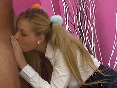 Ivana is a cute blonde with pigtails, schoolgirl outfit and big natural tits who doesn´t mind an old priest filling her up with sperm