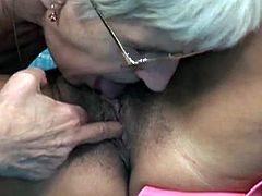 Two granny lesbians licking and toying the pussy in this video.