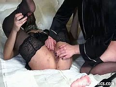 A brunette babe is down on all fours while the other one has her fists deep in her pussy and her ass hole. They switch roles and the brunette babe returns the favor.