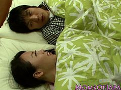 Busty Japanese housewife titfucking her husband