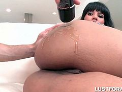 Super hot brunette gets her oily ass fingered and fucked