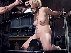 The blonde slut is gaged and tied up by her master in the sex dungeon. He has his way with her and uses many methods to bring her pain. He puts huge clamps on her nipples and even on her nose. How much more of this will she be able to take?