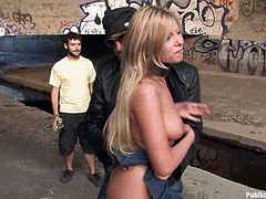 A blonde-haired babe is awfully disgraced by a dominant guy, that exposes her to everyone's horny or curious regards. The bitch gets down on knees and is persuaded to suck cock. Her small fantastic tits are evaluated with lusty stares. See Donna waiting the buss in the street in a very humiliating position.