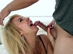 Blonde mature whore Erica has invited her younger next door neighbor over for some fun. She pulls his cock out of his pants and shows just how good she is as sucking a big penis. She is on her knees getting throat fucked really hard.