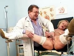 Mature in stockings and boots sees her doctor