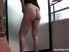 Aroused curly mature masturbating snatch on the terrace