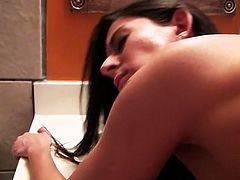 All natural brunette nympho Nikki Daniels gets fucked on the toilet bowl