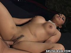 Plump Asian babe Mika Tan is fucked in her pussy and anal hole in missionary position