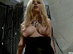 Busty blonde fondling her big natural tits in a close up solo shoot