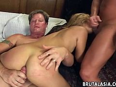 Two sex-crzy dudes fucks hard gaped anal hole of one lustful Asian chick
