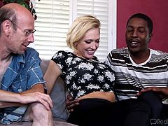 This sexy blonde slut is tired and fed up with her husband, not being able to fulfill her sexually, so they go out to find a black guy with a big dick, that can spice things up. She sucks black cock and her husband has to watch her do it.