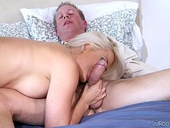 This blonde slut loves cock so much, that she wants to take it from both ends. She gets fucked hard from behind by one guy, and sucks on the other's rock hard cock. Look at her slurp and suck, while being pounded. She jacks off her lovers with one cock in each hand.