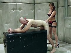 This cruel mistress lifts up her slave way above her head. As she balances him on her shoulders, the other mistress shoves the sex toy up the slave's ass. They tie him to the chest with rope and he gets assfucked.