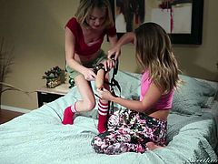 Blonde whore Carter explains to her younger, inexperienced girl, Dakota, how a strap on works. She loves to look in her beautiful hazel eyes and see the lust within her. Soon, she convinces Dakota to strip naked and spread her legs. After that, she eats her pussy and then prepares the sex toy. Watch!