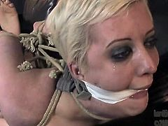 Bondage busty blonde gets her pussy punished with black sex toy