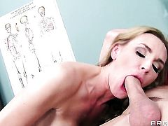 Johnny Sins ejaculates after Tanya Tate with massive jugs gives magic mouth job