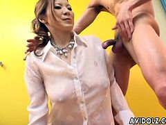 Kinky Japanese MILF in white shirt plays with dildo and sucks dick