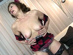 If you are into hot and horny mature women, don't hesitate to click! Slutty Danny is a short-haired versed bitch, who loves the camera and is hardly waiting to play with her naughty cunt. The sensual lady wears kinky sexy lingerie and removes each item little by little, offering a delightful spectacle...