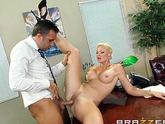 Who said work can't be pleasant? The guy in the office cannot take his eyes from Rhylee's big breasts. The blonde-haired business woman let's him explore her body and undresses with sensual movements, laying then on the desk. Click to see the horny man, eating the milf's peachy cunt, and fucking her hard.
