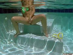 Naughty blonde Chase with toned body takes off her tiny bikini in the pool and opens her legs. She exposes her hairless tight pussy under water. She spreads her pussy lips for your to watch,