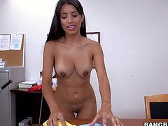 Cleaning girl Soffie is a sexy breathtaker with long black hair, big tanlined boobs and hot ass. Well stacked chicana poses topless and then bares her bubble ass in a playful manner