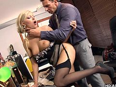 Naughty blonde in lingerie is getting pounded in an office