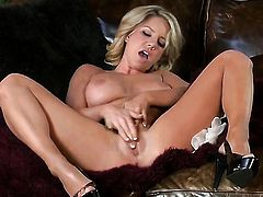 Tender tart Ainsley Addison touches her hooters in a playful manner