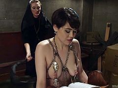 audrey has some sadistic fun with sexy nun