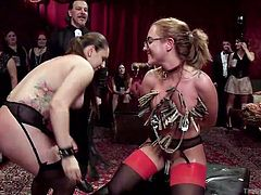 Roxanne and Tori don't mind making a quick buck and John Strong doesn't mind giving them the right opportunities. Watch the two hot chicks getting clamps on their nipples, as John Strong makes sure everyone watching gets a value for their money. He makes them do some sexy things and then, fucks them in front of the crowd in the party and it doesn't look like the girls mind.