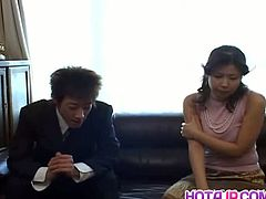 Marin Asaoka enjoys showing off her big tits in the office where she is secretary to the boss. She also services him on his lunch break which is what you see here. On the couch in his office he takes her panties down and spreads her legs so her hairy cunt is open to him. He then licks and sucks her clit to turn her on and get her hot for what is coming next. He plays with her big tits before putting her on top of him so he can watch her face as they fuck. Then he is back to fingering her cunt before having her suck his hard cock until he shoots his load off.