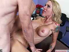 Big breasted blonde sex teacher in glasses and high heels Sarah Jessie gets nailed by her younger student