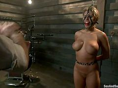 Well stacked American porn actress is tied up and punished