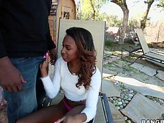 Slutty black chick, Armani Monae, is so horny all the time, that she doesn't mind sucking a cock or two, while she is walking on the street. Armani does not like to waste her time and gets down on her knees, to suck the biggest and the hardest cock, when she sees it. And after she is done lubricating it with her yummy mouth, she lets it into her hot little cunt.