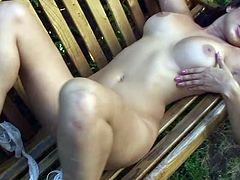 Incredibly hot boobalicious brunette Sunny Leone masturbates on the bench