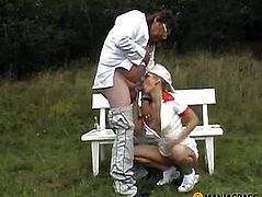Pissing on the green grass girl