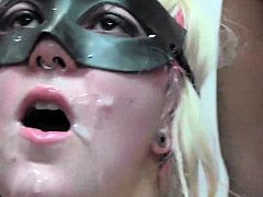 Bukkake blonde in a mask eats cocks in gangbang