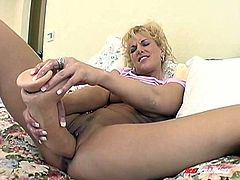 Big tittied blond milf drills her stretched pussy with fake cock