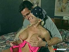 A blonde with monster tits works out and gets fucked