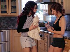 Slutty lesbian April, was exhausted after a long workout and was merely in the kitchen to grab some juice. But Raven there had some other intentions. She grabs sexy April and undresses her. She kisses her, to turn her on. April leans on the kitchen counter, her panties gone, it gets easier for Raven to lick and finger her shaven and tight pussy.